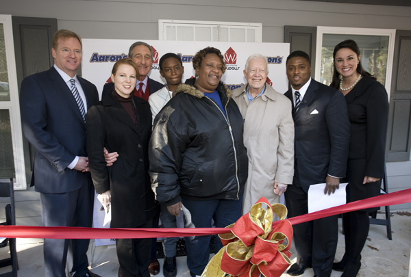 cutting the ribbon at 100th Homes for the Holidays home reveal