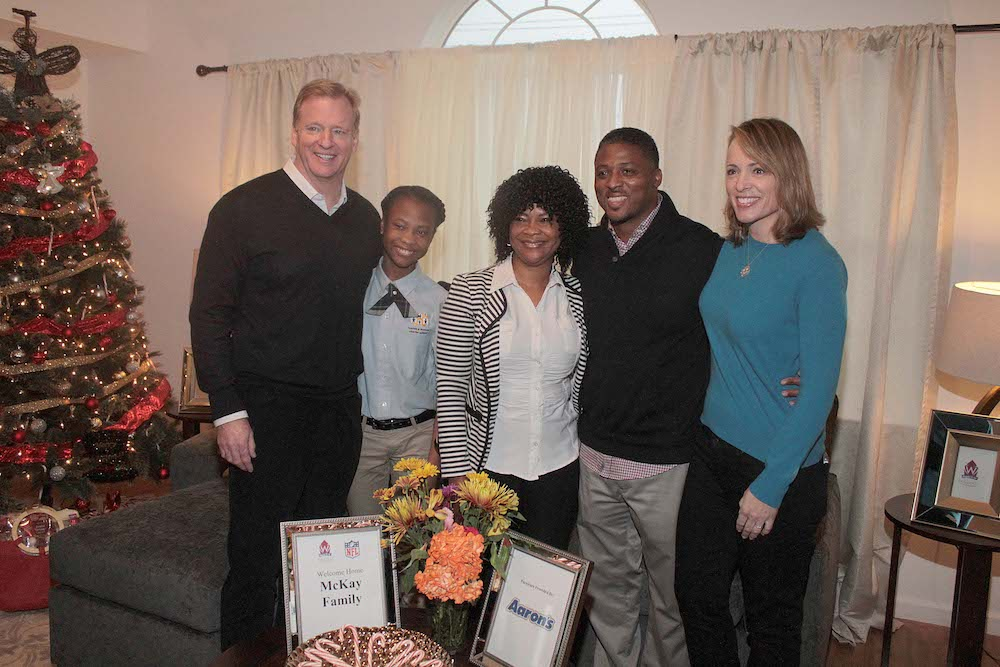 Warrick with recipient family of 150th Homes for the Holidays home