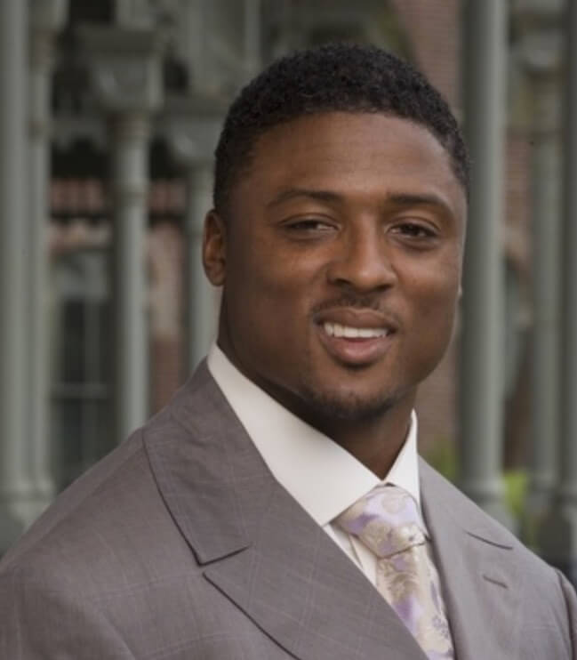 Warrick Dunn headshot in suit