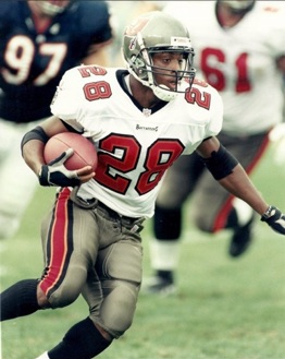 Warrick Dunn running football for Buccaneers
